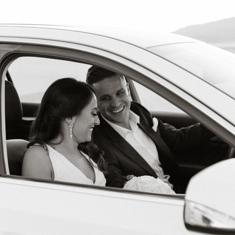 bride and groom leaving in car together
