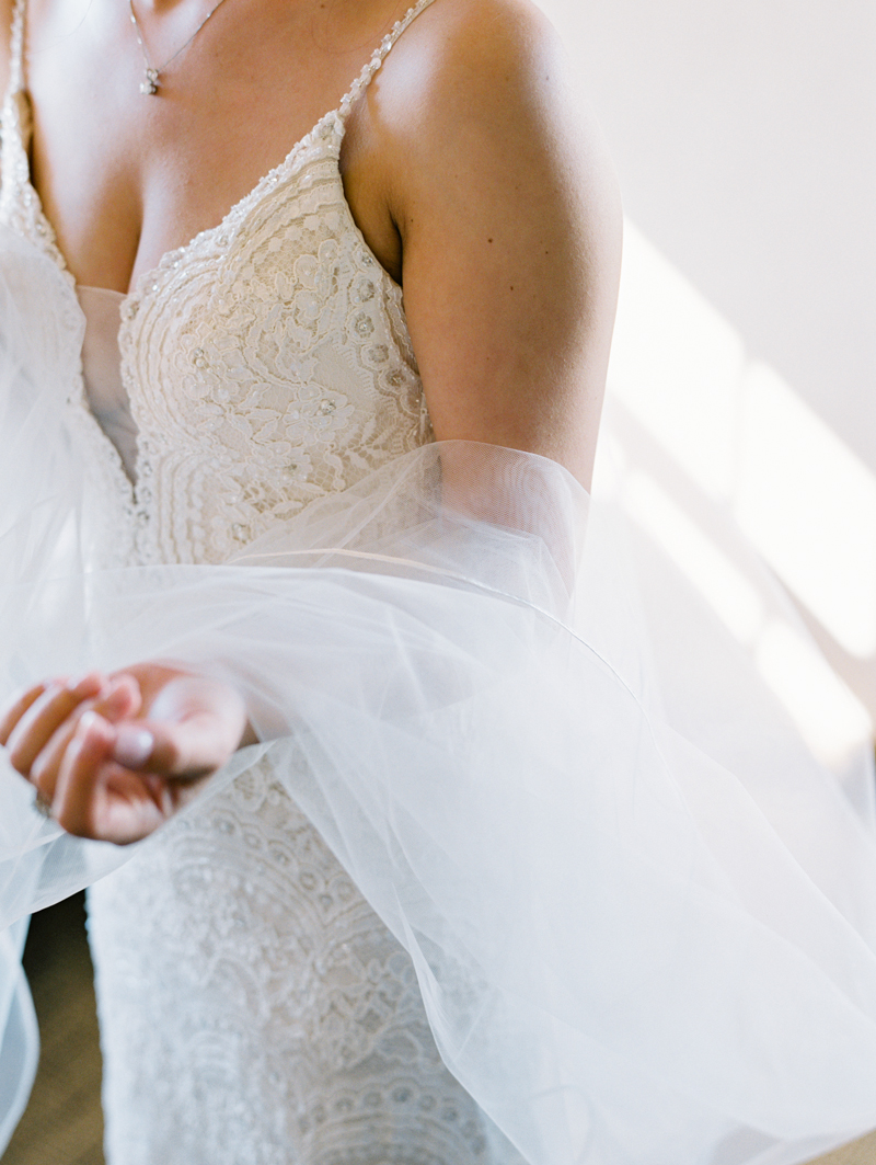 bride holding veil