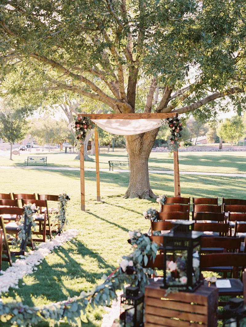 DIY wedding ceremony arch with flowers