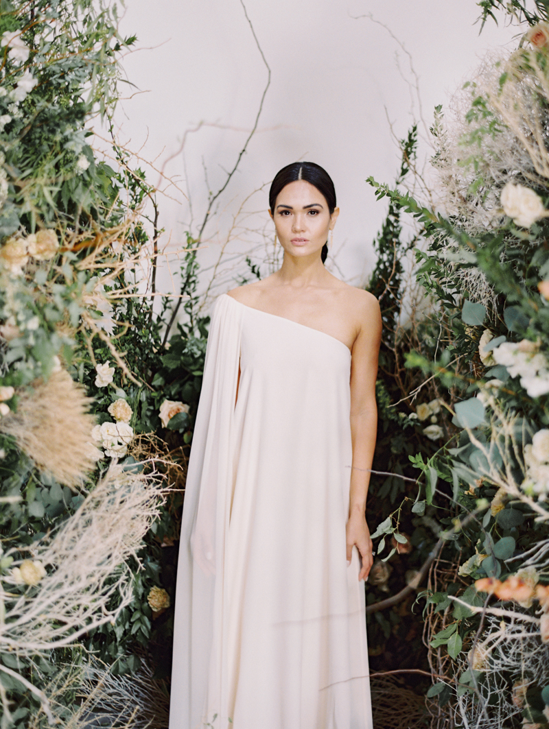 editorial wedding inspiration with floral and tumbleweed ceremony arch