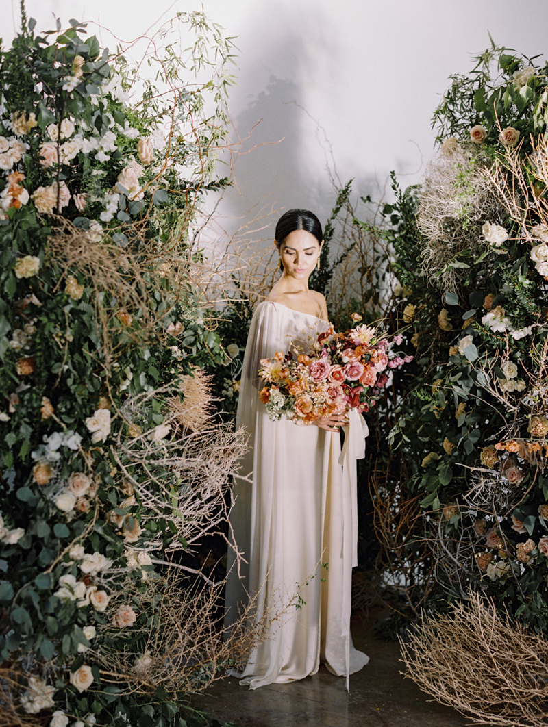 runway wedding inspiration with flower bomb arch