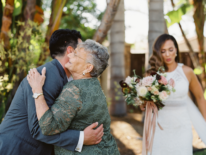 groom hugging grandma emotional moment