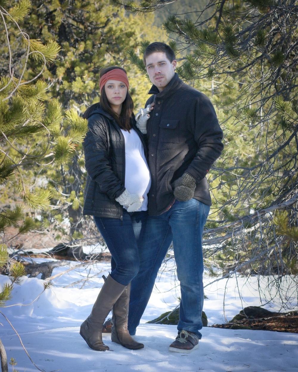 Maternity couple snow