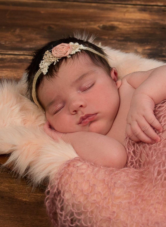 newborn girl peachy and pink