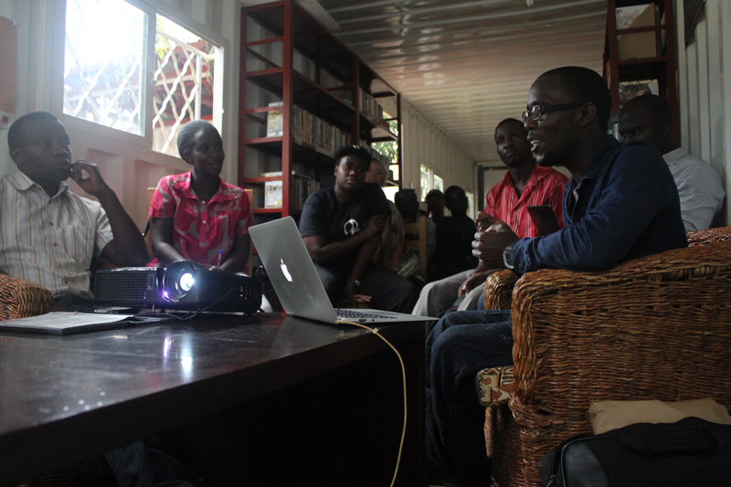 Artist Benon Lutaaya gives an artist talk in the library at 32° East
