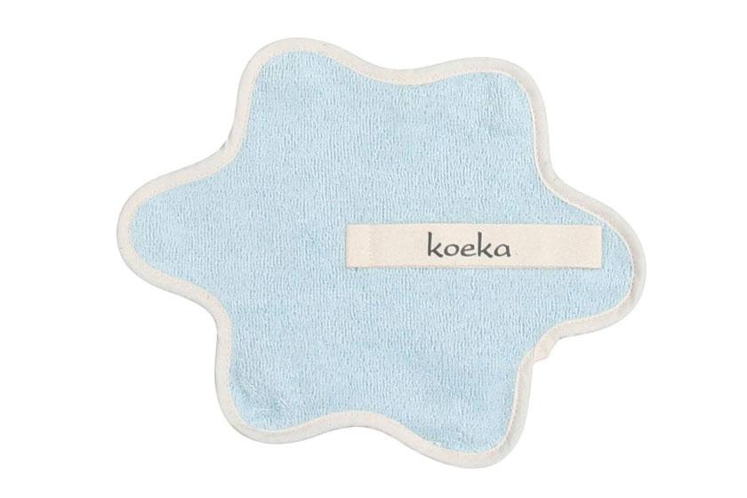 Bloemvormige speendoek met lus werd het symbook voor de zorgfactor van de Koekacollectie.