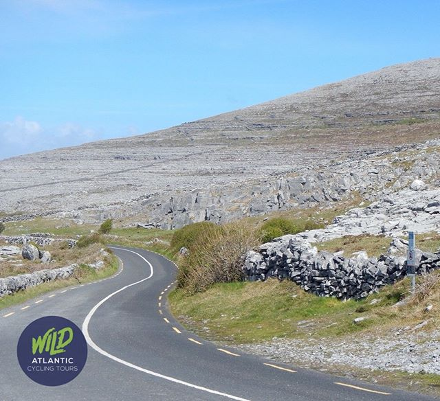 The roads through the Burren in County Clare are breathtaking . www.wildatlanticcycling.com #theburren #cycleireland #cycletouring