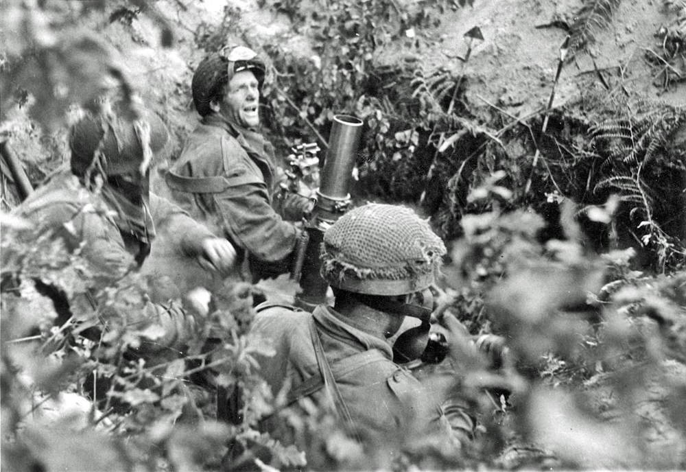 British troops man a 3-inch mortar during the fighting at Arnhem, September 1944.