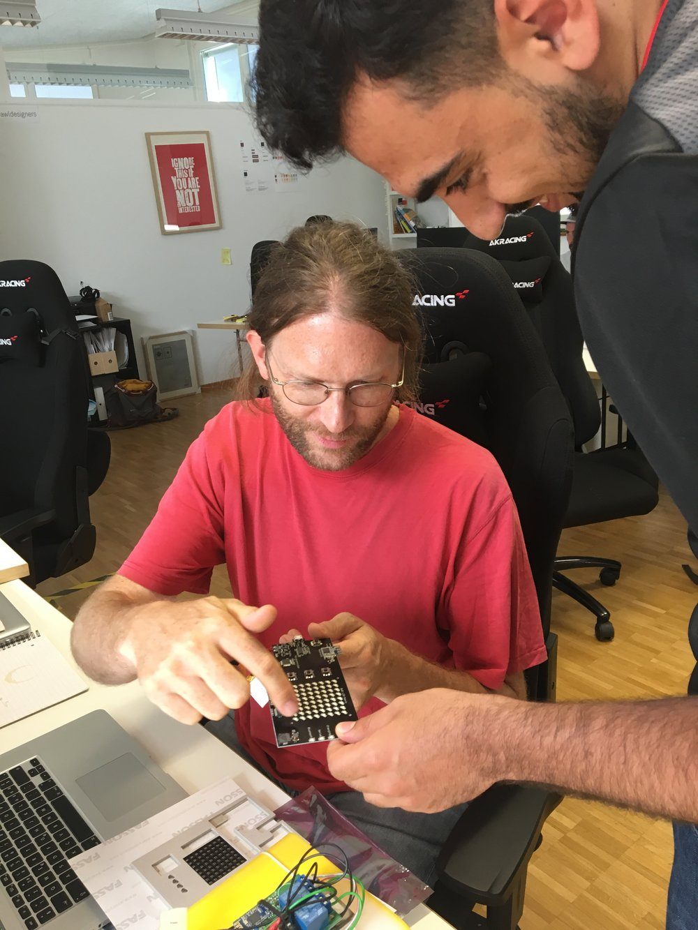 Deaa and Apps with love CTO Olivier Oswald discuss and inspect the hardware of a development kit.