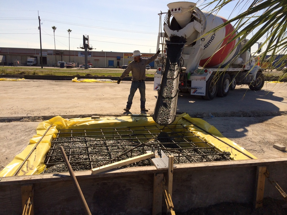 Pouring concrete footers.
