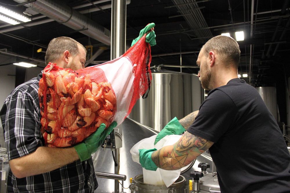 Casey and Derrick add fresh crab claws to Captain Jack's Stone Crab Stout.