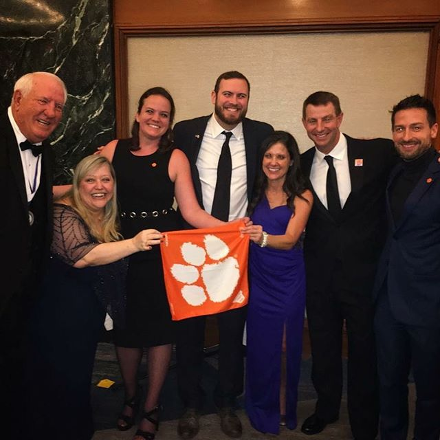 What a crew! You'd think we could hold a Tiger Rag correctly by now...||#ClemsonFamily #CUinNYC 🐅