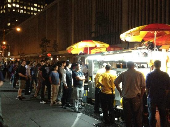 New Yorkers lined up around the corner to eat Halal Cart food. Put simply, it's delicious.
