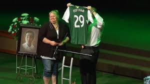 Emilio Hoffman's mother received her son's soccer jersey during a memorial service after he was killed on June 10, 2014. His teacher said he was a star student  Photo Credit: FOX 12 Oregon
