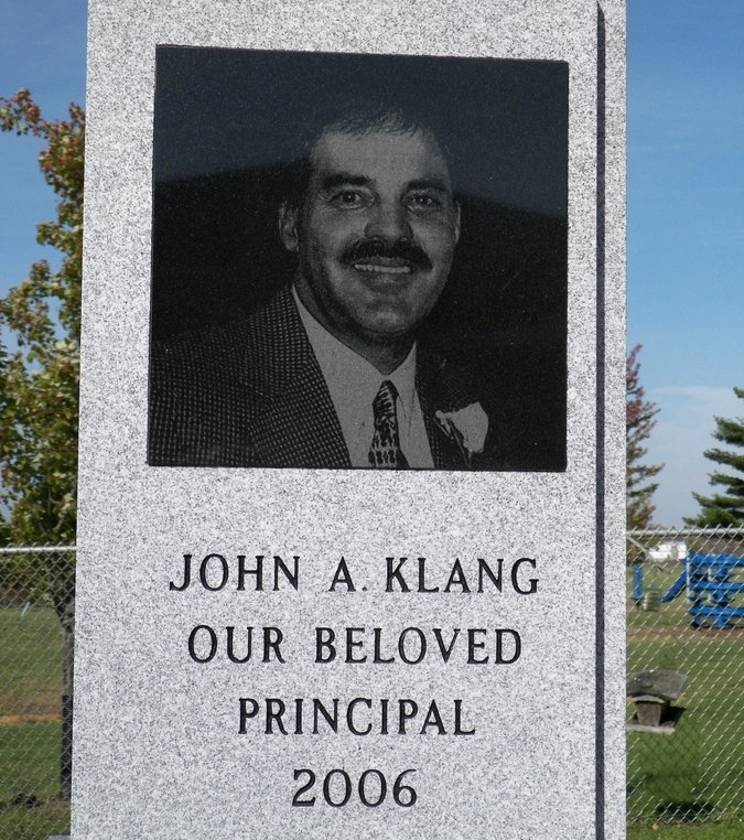 The grave site of John Alfred Klang. The principal was shot with .22 caliber revolver on September 29, 2006. He died later that day in the hospital.