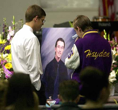 Students pay their respects at a memorial service for Randy Gordon who was shot and killed with Bryan Zuckor on March 5, 2001. Thirteen others were injured.