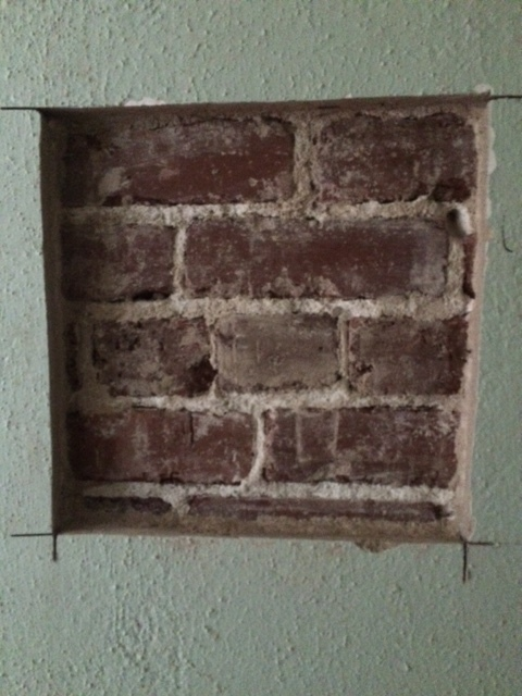 exposed brick sample in kitchen.jpg