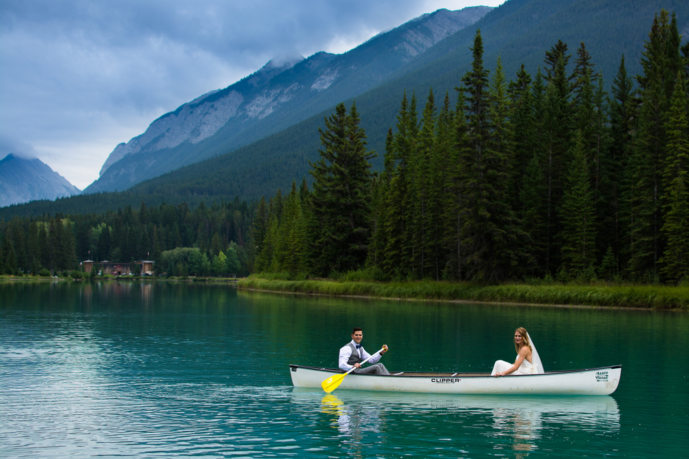 Married Wedding bride and groom riding a canoe on the Bow River, Banff, Alberta, Canada
