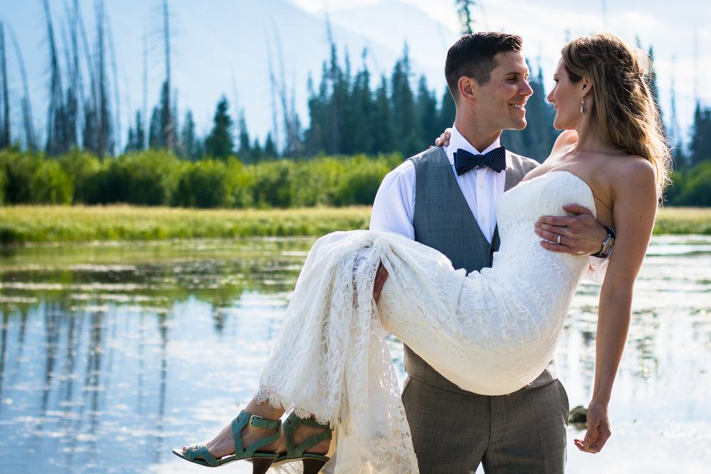 Married Wedding Groom holding bride by Vermilion Lakes Banff Alberta