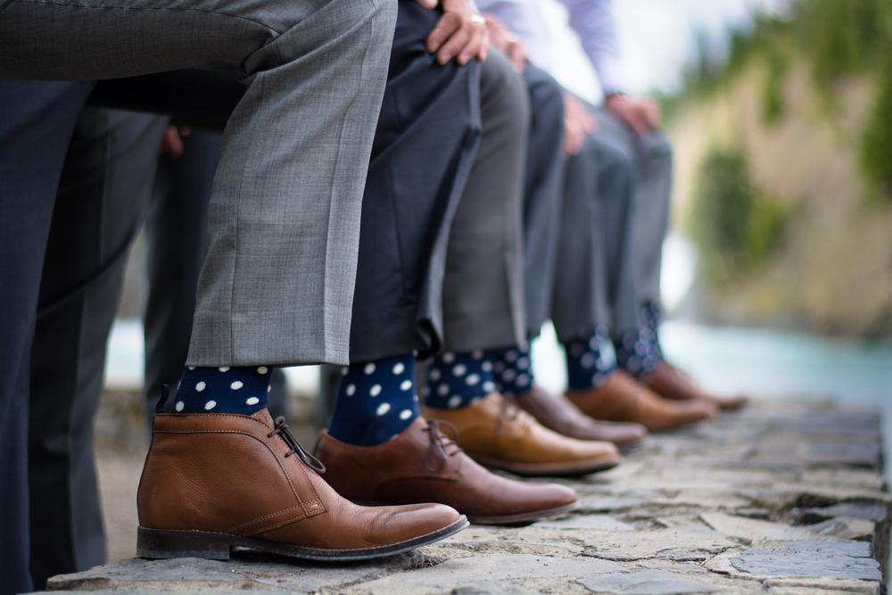 Groomsmen showing polka dot socks