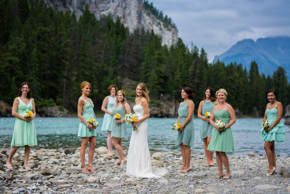 bride and bridesmaids at Bow Falls, Banff, Alberta, Canada