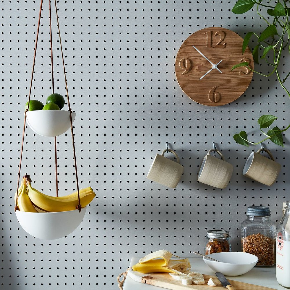 Hanging Two-Tiered Ceramic Fruit Basket (via  Food52 )