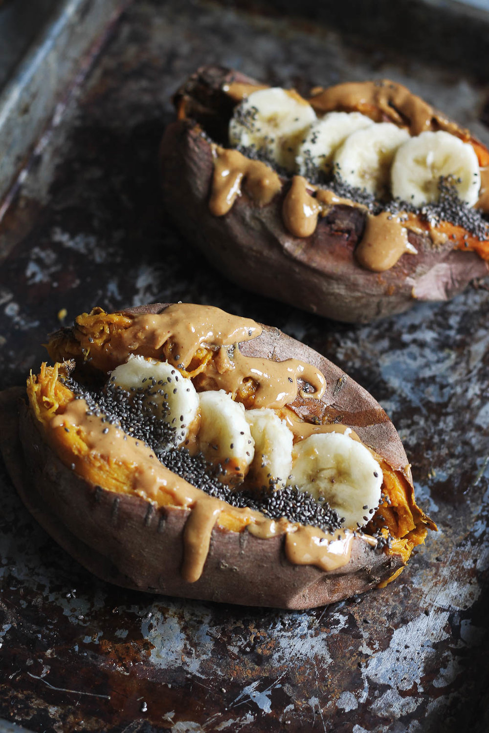 "I love  Monique (Ambitious Kitchen)  and her recipes always make me drool, especially this ""Breakfast Baked Sweet Potato with Almond Butter, Banana & Chia."" (image via  ambitiouskitchen.com )"