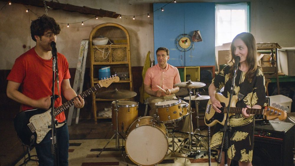 """Band Aid."" Zoe Lister-Jones stars (writes and directs, too) alongside Adam Pally and Fred Armisen in the story of a couple who, in the wake of a miscarriage, can't stop fighting, so decide to turn all their fights into songs and form a rock band to save their marriage. (via teasertrailer)"