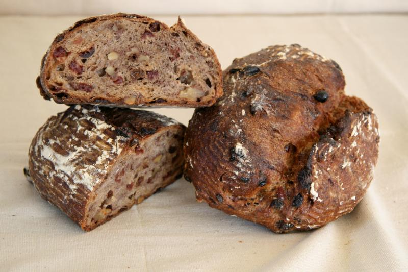 "Thanks Mom and Dad for schlepping this from Berkeley!  ""The natural sugars from the cranberries and raisins make it a great choice for breakfast toast or mildly sweet snacks throughout the day. This bread also sticks to your ribs and keeps you feeling full and well-nourished for hours on end.""  (image via  acmebread )"