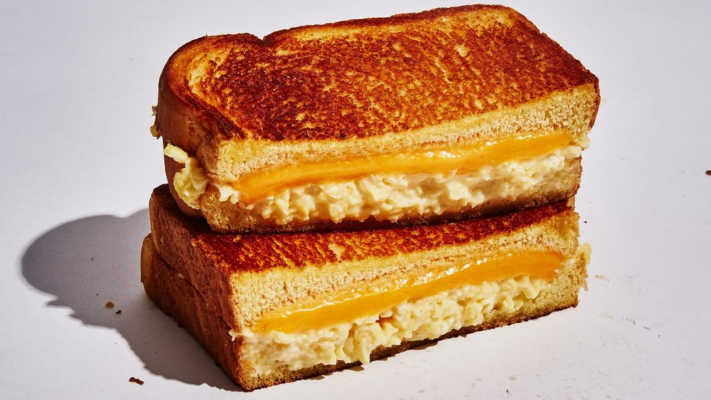 "I love this picture and would frame it.  ""Wylie Dufresne's Scrambled Egg Sandwich.""  (image by Alex Lau via Bon Appetit)"
