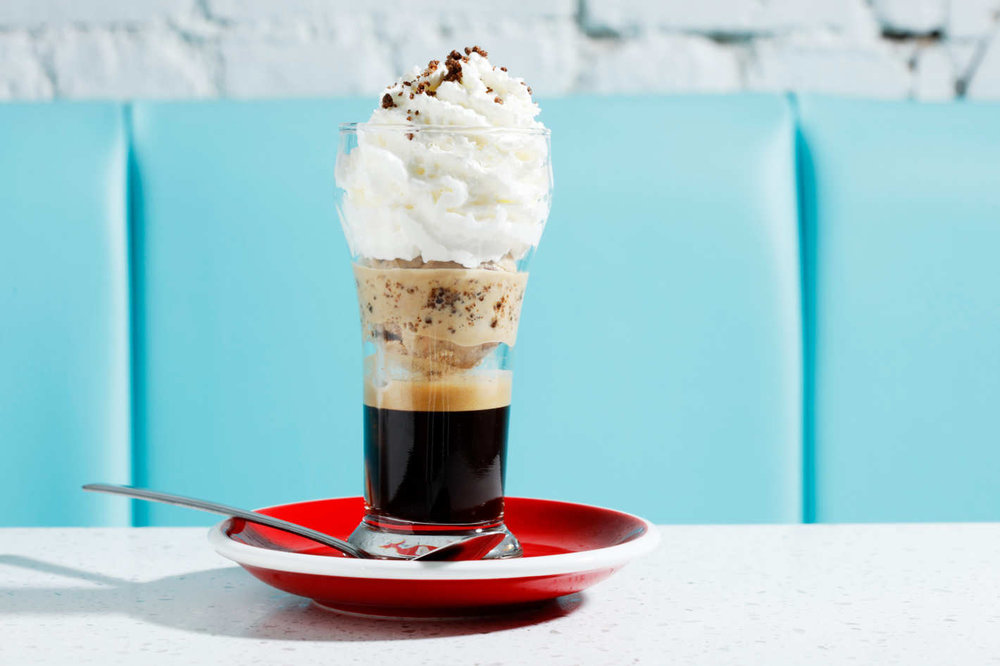 "The café liégeois, a sort of parfait meets sundae made with espresso, coffee-crunch ice cream, wafer cookie, and coffee ""soil.""  (Photo by Melissa Hom via nymag)"