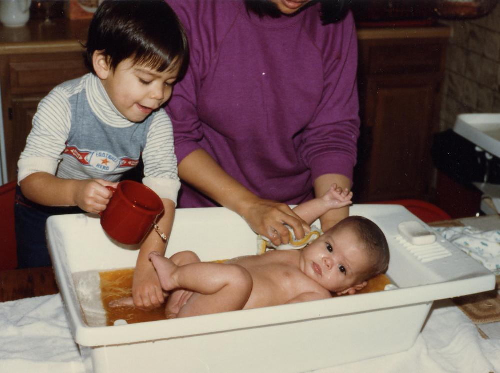 018 Brandon helping with bath - 3 mos.jpg
