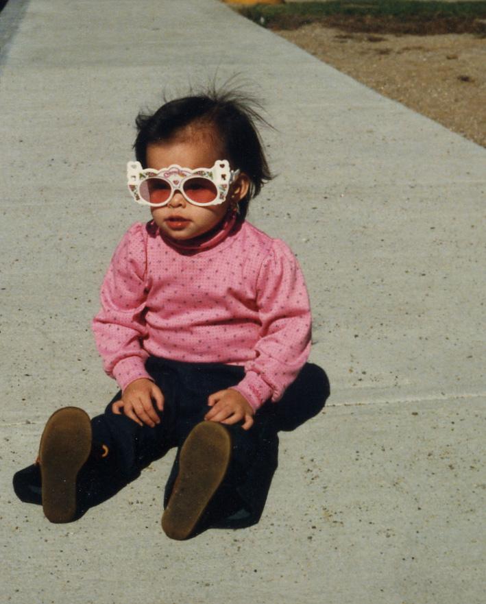 062 sitting on sidewalk with funny glasses.jpg
