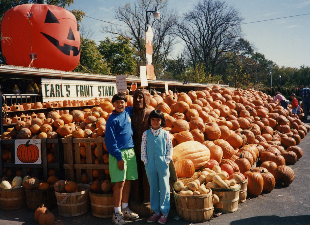 107 w Brandon at pumpkin stand.jpg