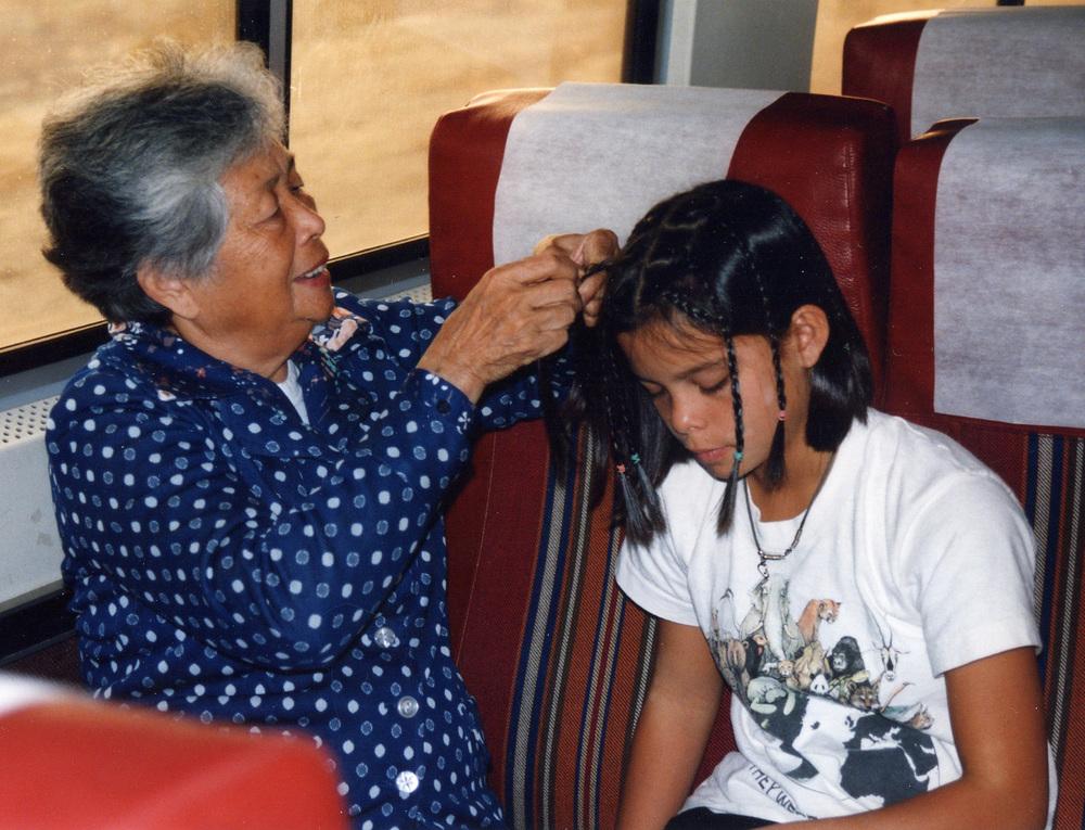 124 Grandma Josie braiding hair.jpg