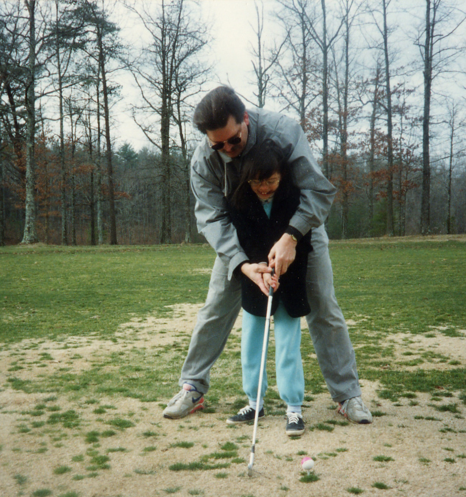 451 Tom and Sarah playing golf.jpg