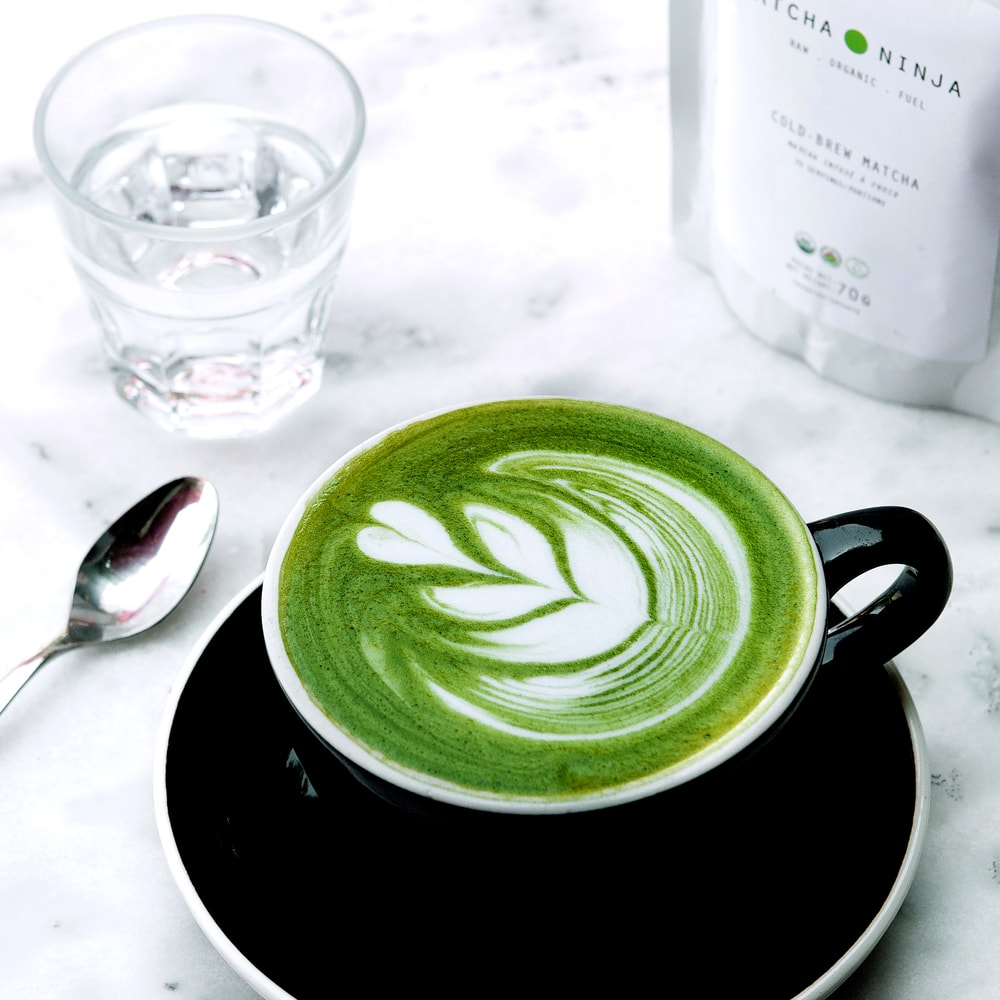 - Ingredients:½ cup hot water½ cup organic almond/ coconut milk 1/2 teaspoon Matcha Ninja1  tablespoon honey, maple syrup, or stevia to taste (optional)