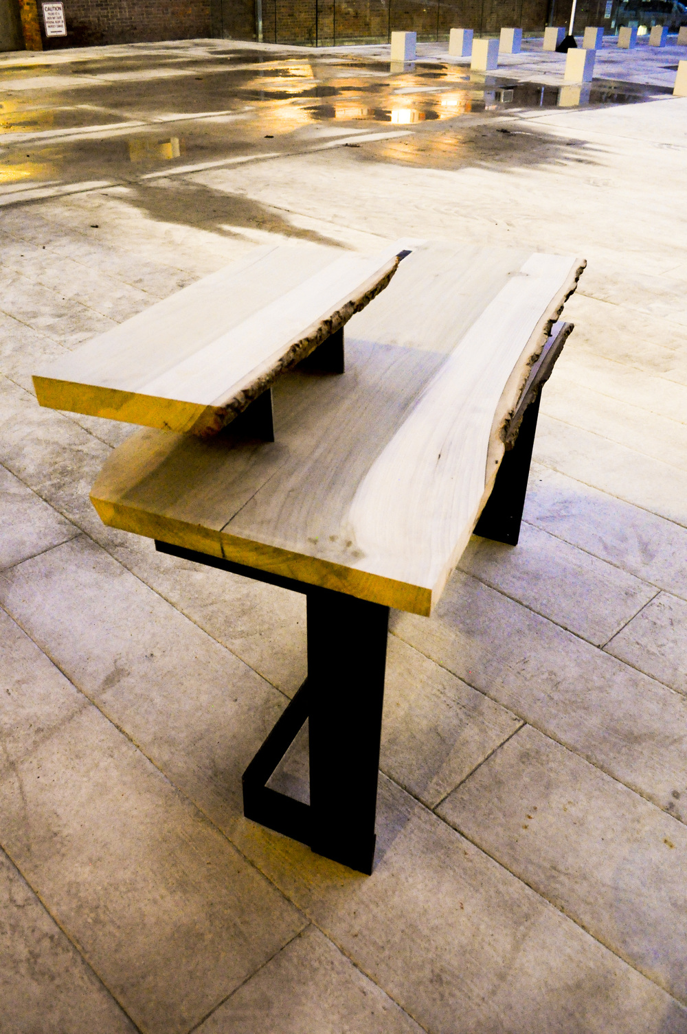 A surface for ideas - Natural-edged poplar combined with a steel base. Constructed by folding the metal through the wood, suspending the slab in the air and making a space for one to sit, ponder and manifest ideas into life. Approx. size: 50