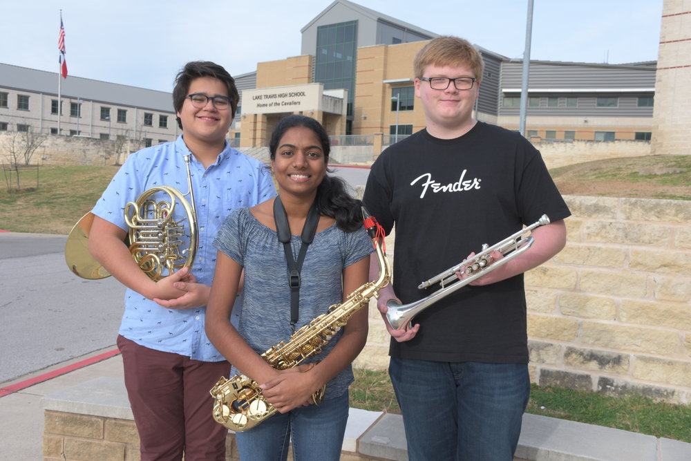 Band: (left to right)  Brandon Aguillon , sophomore;  Sreya Ayinala , senior; and  Bryce Calder , junior