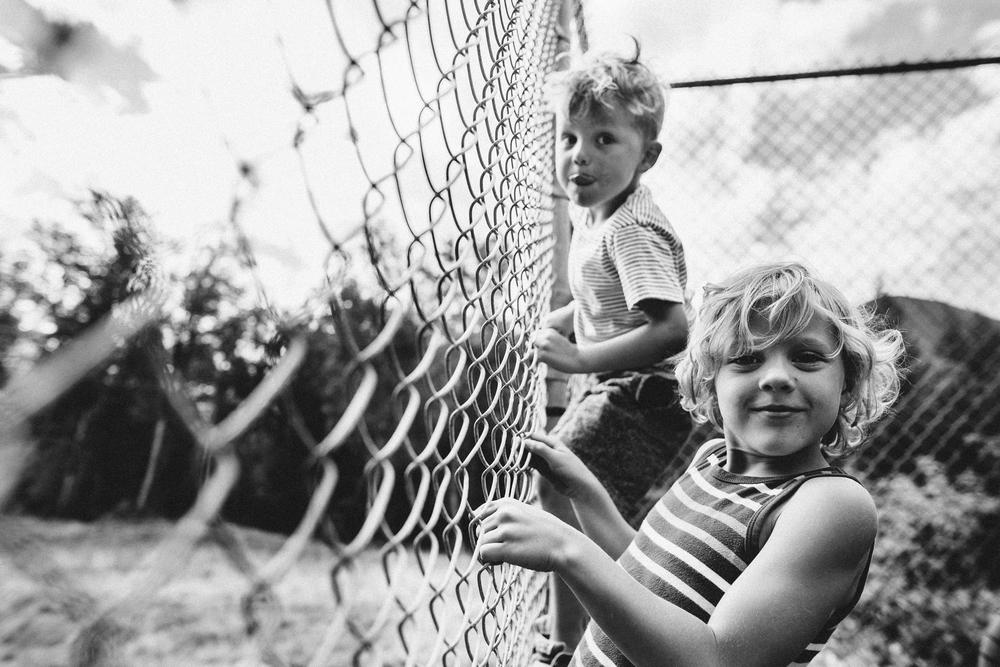 wyatt atticus climbing tennis court fence-1.jpg