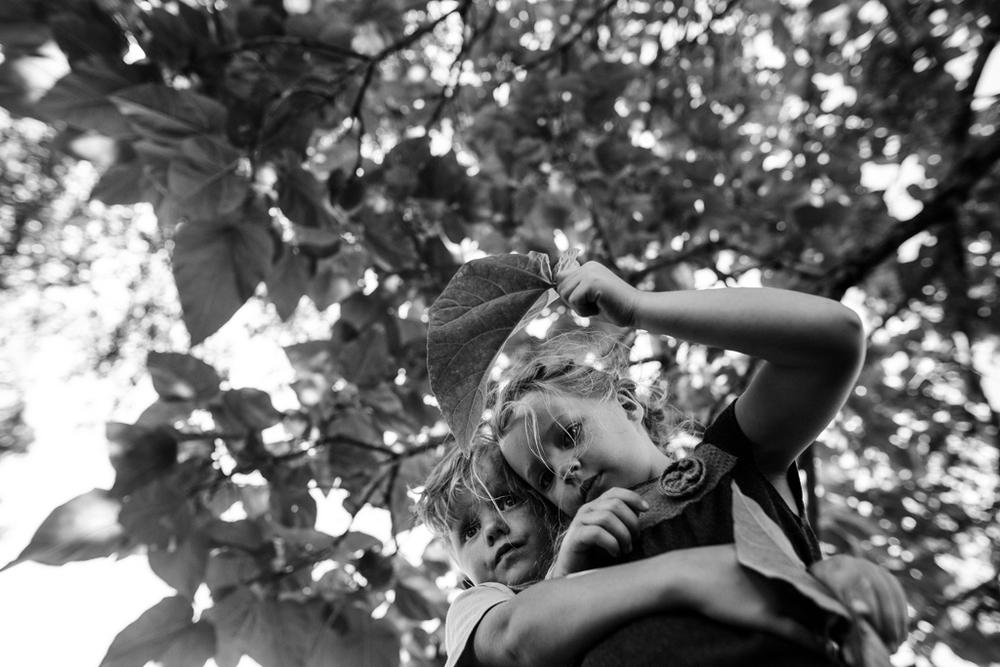 Bennett And Atticus hugging under banana tree-1.jpg