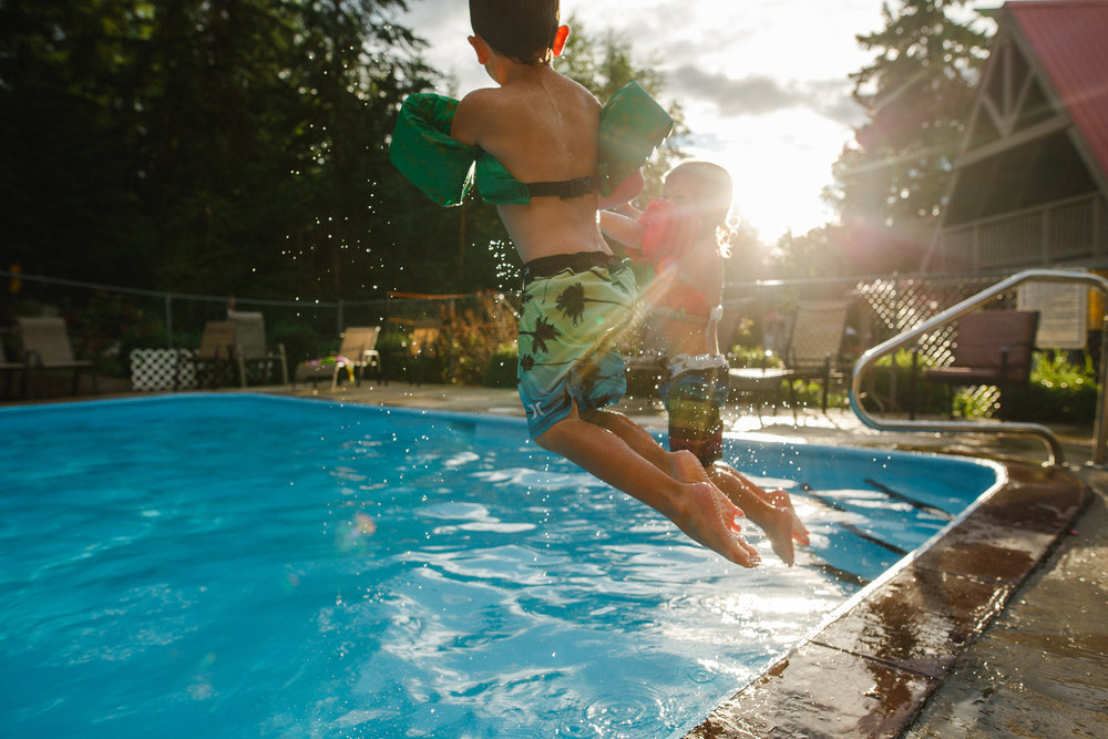 the boys calgary jumping in pool-1.jpg