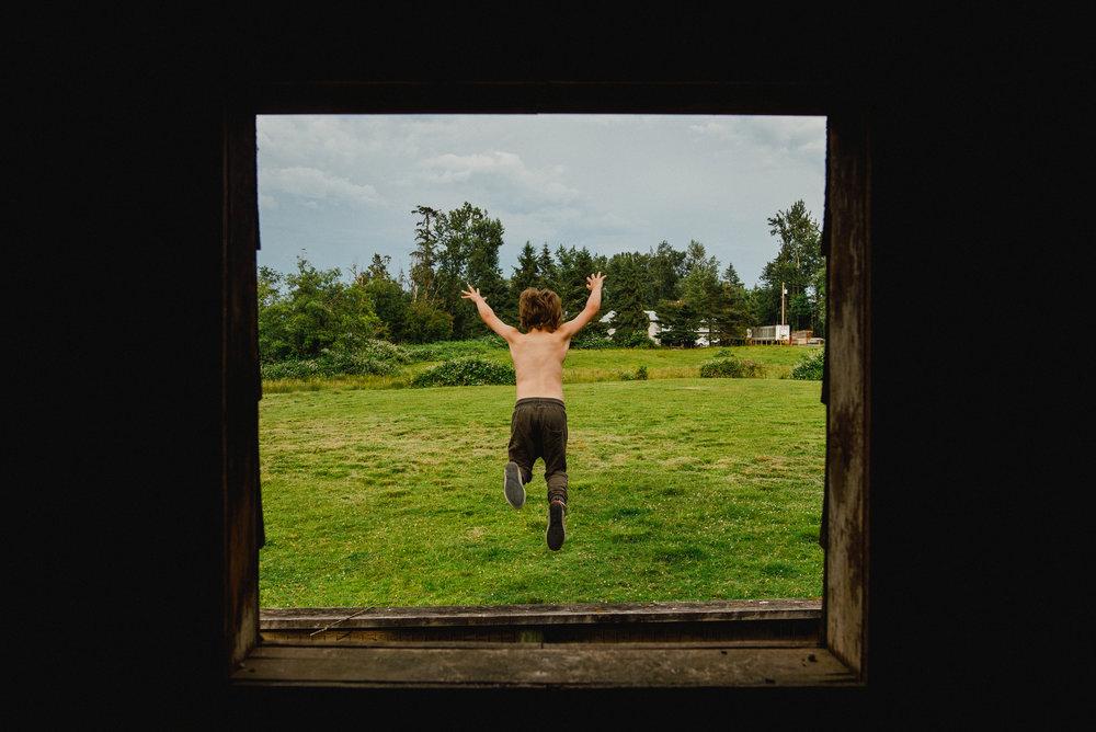 atticus jumping off fence through playhouse window-1.jpg