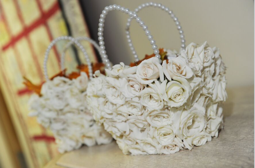Photo Credit: A Magic Moment Photography Speaking of our flower girls, we suggest real floral on the baskets. Depending on your style we can add more accessories such as these pearl handles.