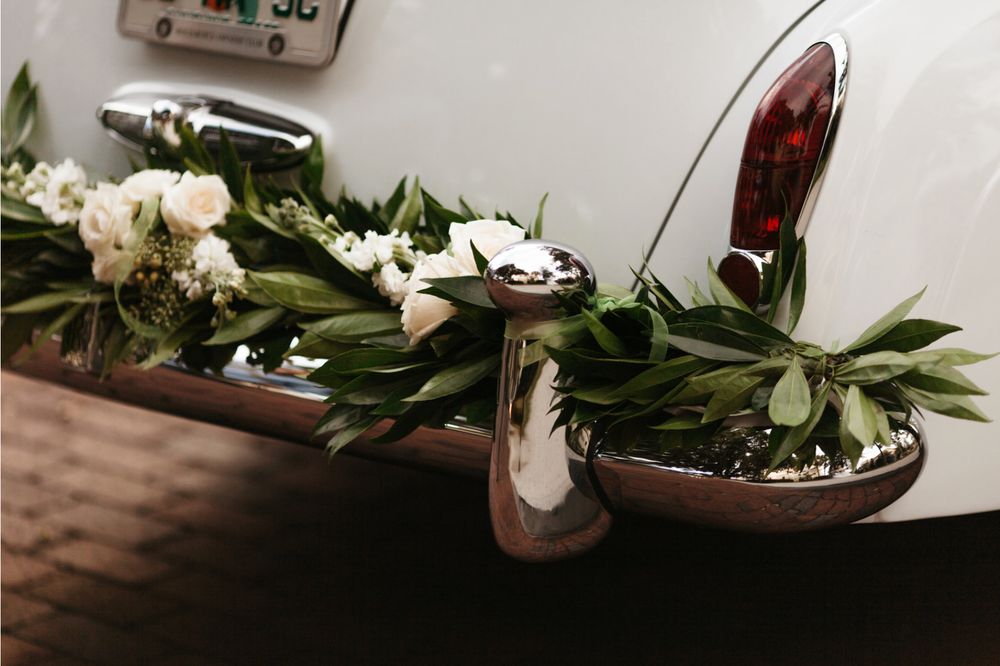 Photo Credit: Chris Glenn Photography What about a floralscape for the getaway car after the wedding?