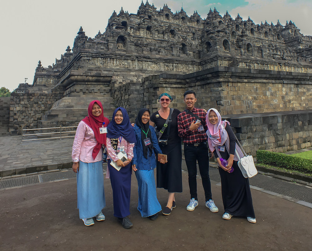 Tess at borobudur temple, indonesia, with local young people