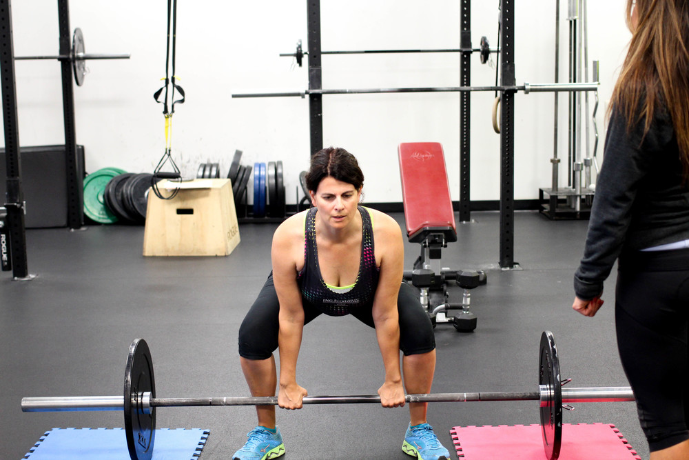Heather personal training doing a dead lift