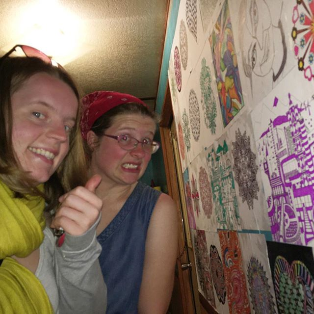 Little sister and I gluing coloring pages to the wall of my trailer. Cheaper than wallpaper!!