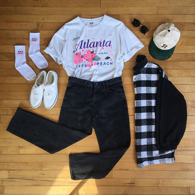 "Life's a 🍑 . Closing sale's going strong, 15% off all vintage! . Atlanta tee XL Rustler jeans W32"" White sneakers size 9  Flannel polo size L  Evian socks 7$  Shades $15  Hat $16"