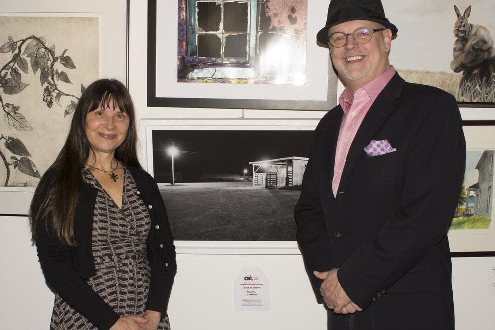 "With  Darrin Martens , Senior Curator at Peel Art Gallery, Museum and Archives (PAMA). Earned a 'Best in show' for my image ""Night"" from the series ""Harry Was a Cow Caller"" at last nights opening of  The Ontario Society of Artists Juried Members Show  -  thank-you  :)- show continues till the end of this month at Todmorden Mills Heritage Museum and Art Centre   #Ontariosocietyofartists   #TodmordenMills   #lisamurzinphotograghy   #lisamurzin   #art   #Torontophotography   #Torontoart   #fineartdocumentaryphotography"
